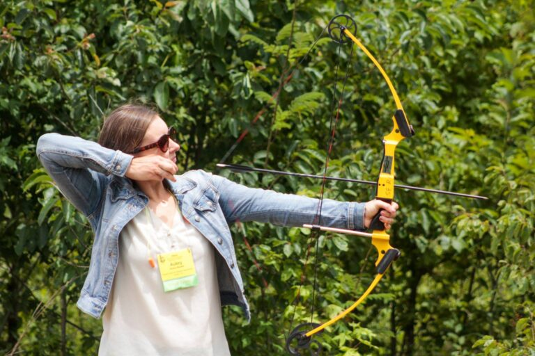 OWAA member draws back on a bow
