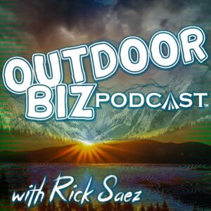 Logo for Outdoor Biz Podcast with Rick Saez, showing a lends flare over a mountain range