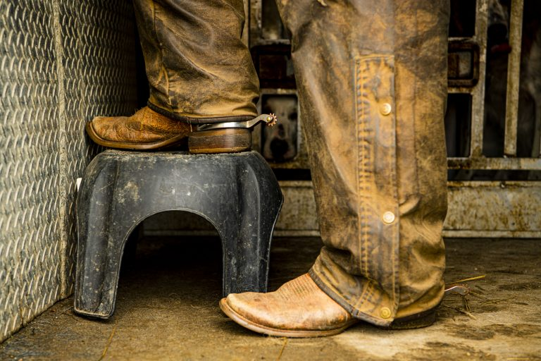 Boots on a footstool