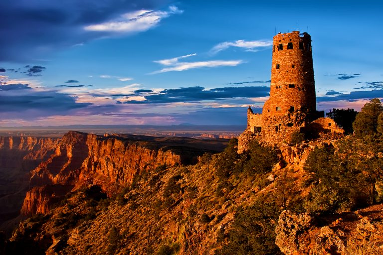 A tower stands by the edge of the Grand Canyon