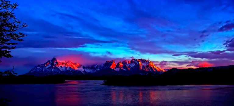 An evocative blue and pink sky over mountains